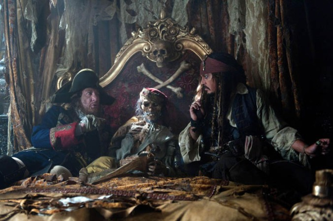 """PIRATES OF THE CARIBBEAN: ON STRANGER TIDES""<br /> Captains Barbossa (GEOFFREY RUSH) and Jack Sparrow (JOHNNY DEPP) find themselves in the skeletal company of the long dead explorer Ponce de Leon in the ruins of the Santiago while searching for the silver chalices necessary to complete the ritual at the Fountain of Youth.<br /> Ph: Peter Mountain<br /> ©Disney Enterprises, Inc. All Rights Reserved."